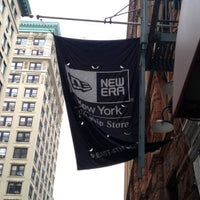Photo taken at New Era Flagship Store: New York by Harvey C. on 10/4/2012