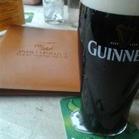 Photo taken at John Mullins Irish Pub by Armand J. on 2/23/2013
