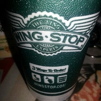 Photo taken at Wingstop by Tania M. on 1/1/2013