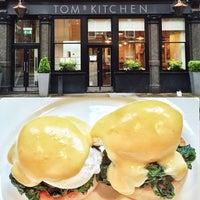 Photo taken at Tom's Kitchen by Tariq M. on 4/7/2014