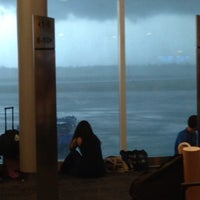 Photo taken at Gate 47 by Rosaleen B. on 8/16/2013