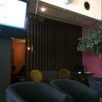 Photo taken at Singosari Lounge by Rudi Y. on 6/12/2013