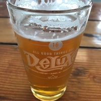 Photo taken at Deluxe Brewing Company by Daniel T. on 6/21/2018