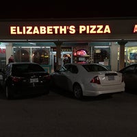 Photo taken at Elizabeth's Pizza Italian Restaurant Pizza and Subs by Kyra K. on 12/3/2015