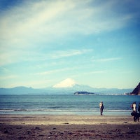 Photo taken at Zushi Beach by masaaki h. on 1/1/2013