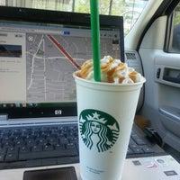 Photo taken at Starbucks by Kuyawes H. on 4/8/2014