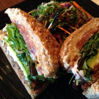 Photo taken at Golden Mean Vegan Cafe by Jane P. on 9/28/2013
