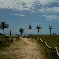 Photo taken at Praia dos Paraguaios by Laiana P. on 12/26/2012