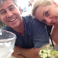 Photo taken at Mulligan's Beach House Bar & Grill by Kelly H. on 8/2/2014