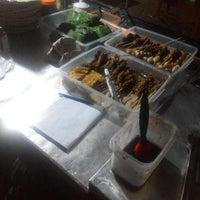 Photo taken at Angkringan Segho Macan by Robhi S. on 1/30/2015