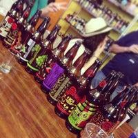 Photo taken at Salud Beer Shop by Jake B. on 3/13/2013