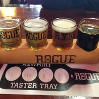 Photo taken at Rogue Ales Brewer's on the Bay by Nick D. on 3/11/2013