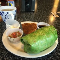 Photo taken at Ross Island Grocery & Cafe by Quinton M. on 5/2/2015