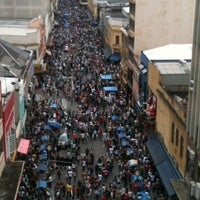 Photo taken at Rua 25 de Março by Flora C. on 11/10/2012