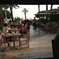 Photo taken at Armani Caffè by Fernando M. on 7/21/2013