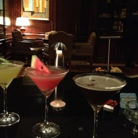 Photo taken at The Library Bar & Cigar Lounge at Four Seasons Hotel Doha by Astrid B. on 9/2/2013