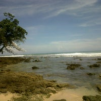 Photo taken at Rancabuaya Beach by Nadya S. on 3/29/2013