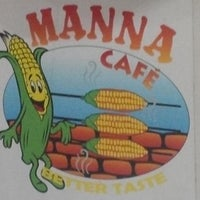 Photo taken at Manna Cafe by Erik C. on 8/9/2014