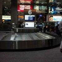 Photo taken at Baggage Claim by Chris M. on 12/23/2012