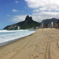 Photo taken at Ipanema Beach by Juan R. on 4/18/2013