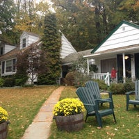 Photo taken at The Woodstock Inn on the Millstream by Tami K. on 10/7/2012