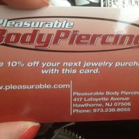 Photo taken at Pleasurable Piercings by Ashley N. on 5/11/2013