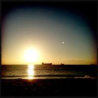 Photo taken at Cape Henry Inn Beach by Milissa S. on 7/4/2013