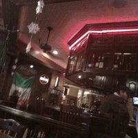 Photo taken at Cork's Irish Pub by David K. on 12/31/2012