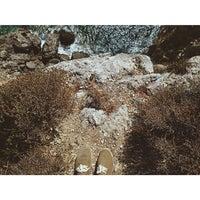 Photo taken at Ermones Beach by Bogdan B. on 9/2/2014