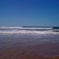 Photo taken at Praia de Ipitanga by Cesar S. on 12/21/2012