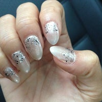 Photo taken at Cute Nails by Angela S. on 12/13/2013
