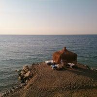 Photo taken at Esenköy Kaya Garden Beach by Tubita on 7/17/2014