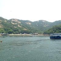 Photo taken at Po Toi Pier 蒲台碼頭 by Nobara F. on 7/8/2014