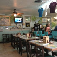 Photo taken at Mangrove Mike's Cafe by Kevin C. on 11/20/2012