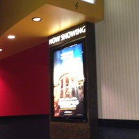 Photo taken at Regal Cinemas Spotlight 14 by Beau M. on 4/16/2013