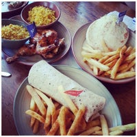Photo taken at Nando's by Adrian O. on 2/2/2014