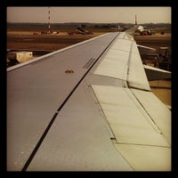 Photo taken at Gate A06 by Andrea P. on 9/18/2012