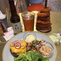 Photo taken at Gourmet Burger Kitchen by Emre Ş. on 4/11/2017