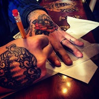 Photo taken at Three Kings Tattoo Parlor by Kimberly T. on 2/20/2013