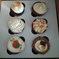 Photo taken at The Sweet Tooth - Cupcakery and Dessert Shop by Jen S. on 10/20/2012