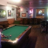 Photo taken at Parrots Bar & Grill by Emily D. on 5/10/2014