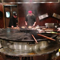 Photo taken at Genghis Grill by Chris B. on 9/1/2013
