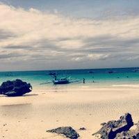 Photo taken at Diniwid Beach by Lenka M. on 1/2/2013