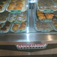 Photo taken at Krispy Kreme Doughnuts by Shana E. on 10/28/2015