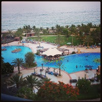 Photo taken at Le Méridien Al Aqah Beach Resort by Abdulla A. on 7/5/2013