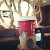 Photo taken at Starbucks by Khang N. on 11/29/2012