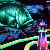 Photo taken at Oceans 18 Glow in the Dark Mini Golf by Oceans 18 on 5/10/2013