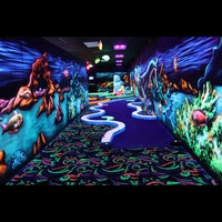 Photo taken at Oceans 18 Glow in the Dark Mini Golf by Oceans 18 on 11/30/2012