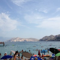 Photo taken at Baška Beach by Nessy K. on 8/9/2013