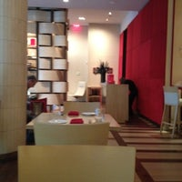 Photo taken at Rouge Tomate by D L. on 10/6/2012
